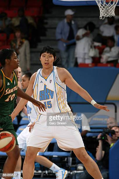 Chen Nan of the Chicago Sky guards Camille Little of the Seattle Storm during the WNBA game on June 14 2009 at the UIC Pavilion in Chicago Illinois...