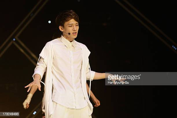 Chen of boy band EXO performs onstage during the MBC Music 'Show Champion' at Uniqlo AXHall on July 10 2013 in Seoul South Korea