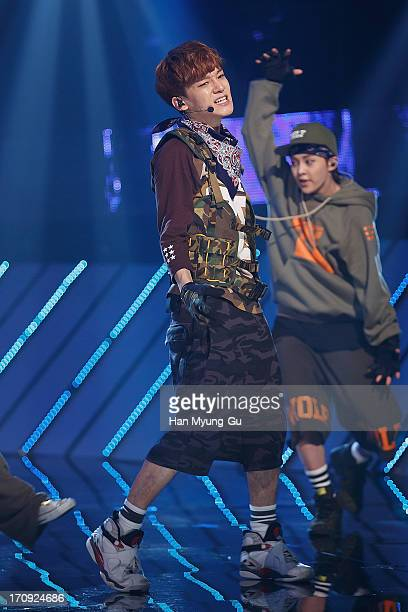 Chen of boy band EXO performs onstage during the Mnet 'M CountDown' at CJ EM Center on June 20 2013 in Seoul South Korea