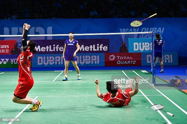 Chen Qingchen and Jia Yifan of China celebrate after winning their women's doubles final match against Misaki Matsutomo and Ayaka Takahashi of Japan...