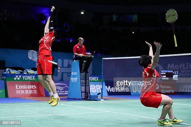 Chen Qingchen and Jia Yifan of China celebrate after winning women's doubles final match against Ayaka Takahashi and Misaki Matsutomo of Japan on Day...