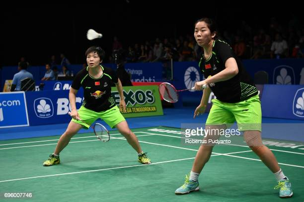 Chen Qingchen and Jia Yifan of China compete against Chow Mei Kuan and Lee Meng Yean of Malaysia during Womens Double Round 2 match of the BCA...