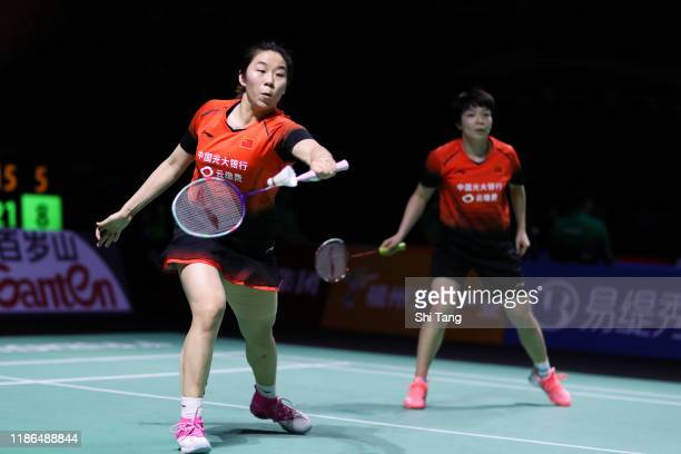 Chen Qingchen and Jia Yifan of China compete in the Women's Doubles semi finals match against Yuki Fukushima and Sayaka Hirota of Japan on day five...