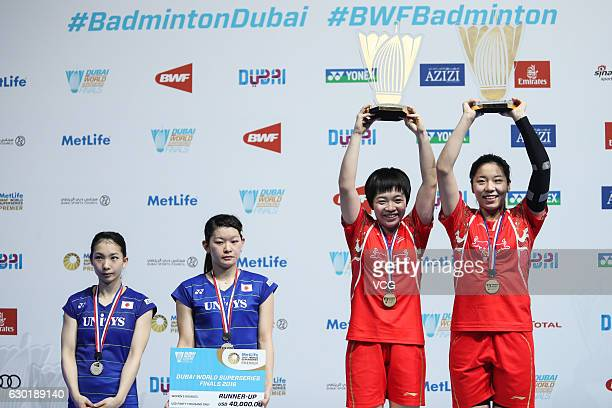 Chen Qingchen and Jia Yifan of China pose with their trophies after winning women's doubles final match against Ayaka Takahashi and Misaki Matsutomo...