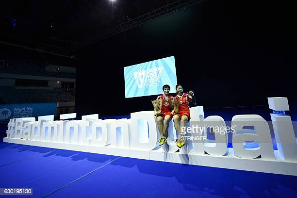 Chen Qingchen and Jia Yifan of China pose with their trophies after winning their women's doubles final match against Misaki Matsutomo and Ayaka...