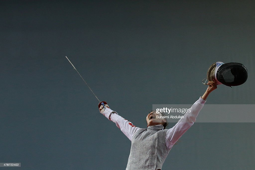 Chen Qinghui of China celebrates victory over Wong Nicole Mae Hui Shan of Singapore in the women's individual foil round of 32 during the 2015 Asian Fencing Championships at OCBC Arena on June 27, 2015 in Singapore.