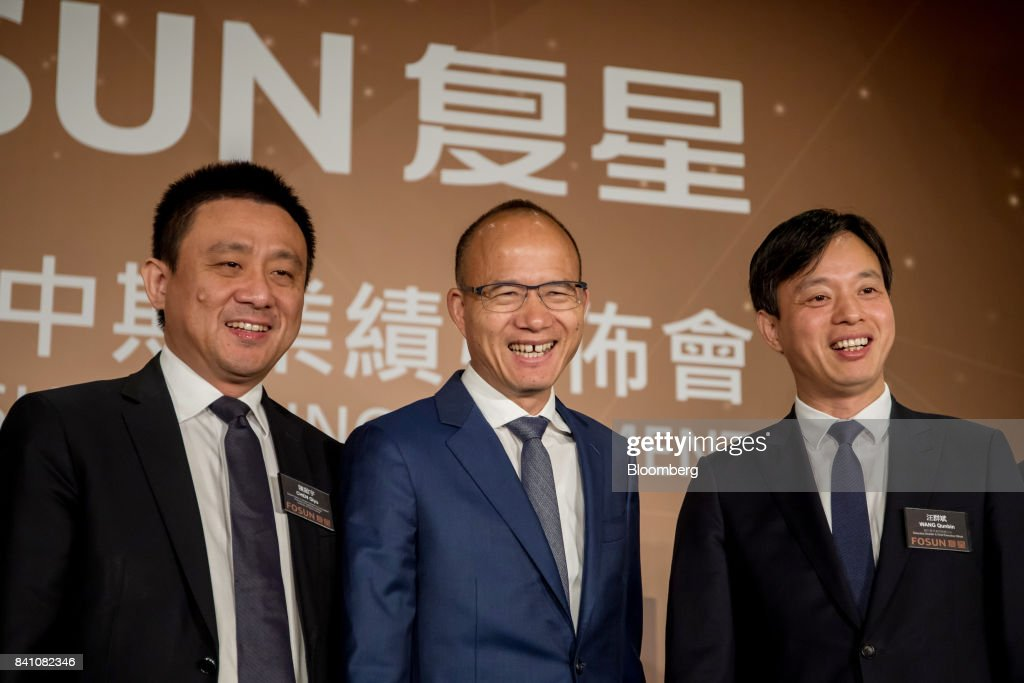Chen Qiyu, co-president of Fosun International Ltd., from left, billionaire Guo Guangchang, chairman and co-founder, and Wang Qunbin, chief executive officer, stand for a photograph during a news conference in Hong Kong, China, on Thursday, Aug. 31, 2017. Fosun the listed flagship ofGuo's insurance-to-drugs conglomerate, reported first-half net income increased 34 percent amid higher returns from investments. Photographer: Paul Yeung/Bloomberg via Getty Images