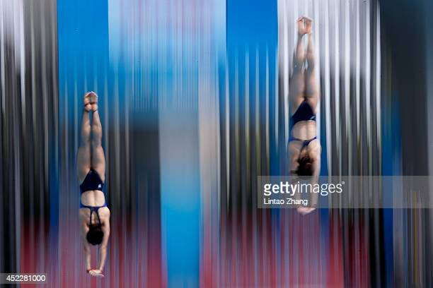 Chen Ruolin and Liu Huixia of China compete in the Women's 10M Synchro Springboard Final during day three of the 19th FINA Diving World Cup at the...