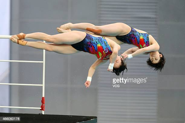 Chen Ruolin and Liu Huixia of China compete in women's diving 10m platform during day one of FINA/NVC Diving World Series 2015 at National Aquatics...