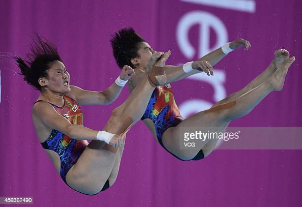Chen Ruolin and Liu Huixia of China competes in women's diving 10 m platform during day eleven of the 2014 Asian Games at Munhak Park Taehwan...