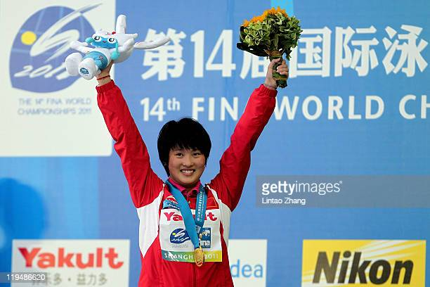 Chen Ruolin of the People's Republic of China celebrates winning the gold medal in the Women's 10m Platform Final during Day Six of the 14th FINA...