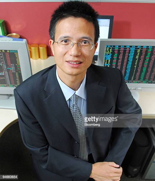 Chen Shide fund manager at Guangfa Small Cap Growth Equity Fund poses in his office in Guangzhou China on Monday July 17 2006 Chen Shide is beating...