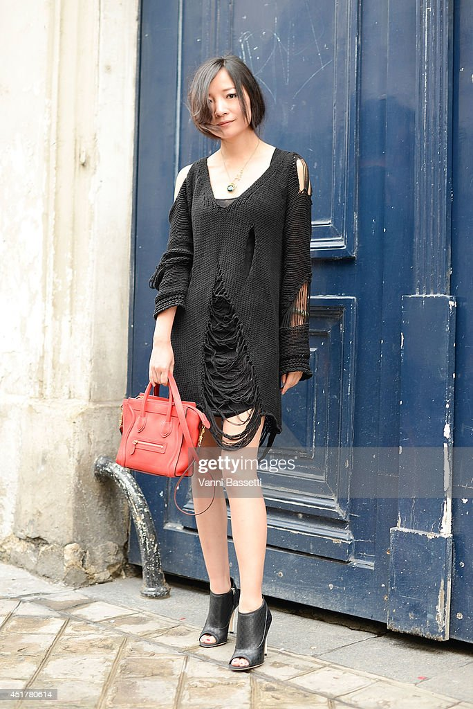 Chen Shuhuan poses wearing an Isabelle Marant dress, Celine bag and Chanel shoes before Fred Sathal show on July 6, 2014 in Paris, France.