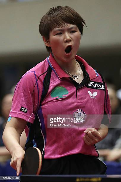 Chen SzuYu of Taipei celebrates a point against Yu Mengyu of Singapore during their Women's Singles Quarter final match on day two of 2014 ITTF World...