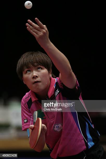 Chen SzuYu of Taipei serves against Tashiro Saki of Japan during their Women's Singles match on day one of 2014 ITTF World Tour Japan Open at...