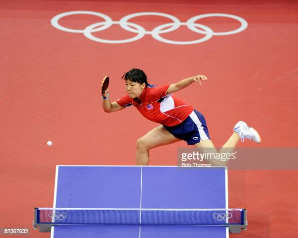 Chen Wang of the USA in action against Iulia Necula of Romania during their Women's Team Bronze Playoff Round 1 match at the Peking University...