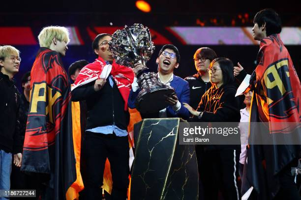 Chen 'WarHorse' JuChih Coach of FunPlus Phoenix lifts the League of Legends Summoner's Cup following victory in the 2019 League of Legends World...