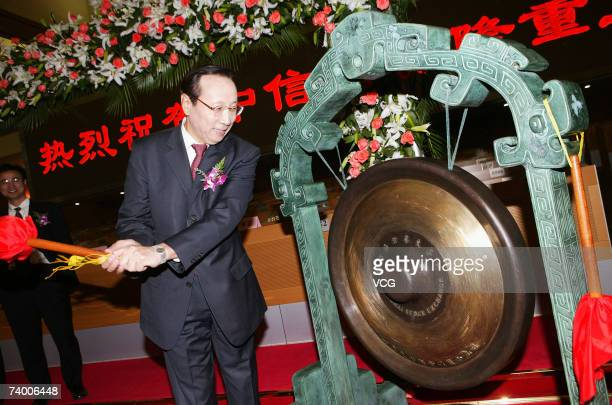 Chen Xiao Xian president of China CITIC bank hits the gong in Shanghai Stock Exchange room during the IPO of China CITIC bank on April 27 2007 in...