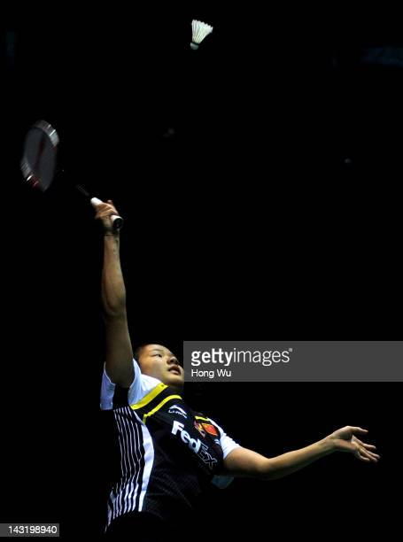 Chen Xiaojia of China plays a shot in the semifinal match against Li Xuerui of China during day five of the 2012 Badminton Asia Championships at...