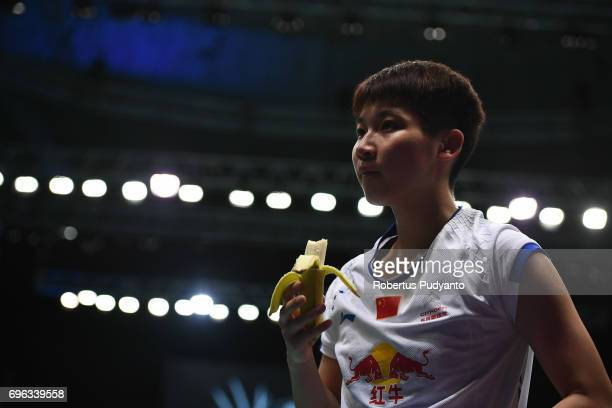 Chen Xiaoxin of China eats banana as she competes against Soniia Cheah of Malaysia during Womens Single Round 2 match of the BCA Indonesia Open 2017...