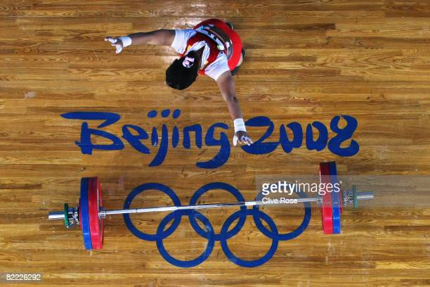 Chen Xiexia of China celebrates her final lift in the Women's 48kg Group A Weightlifting event held at the Beijing University of Aeronautics and...