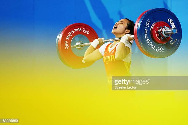 Chen Xiexia of China competes in the Women's 48kg Group A Weightlifting event held at the Beijing University of Aeronautics and Astronautics...