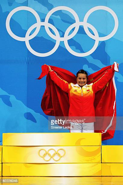 Chen Xiexia of China prepares to receive her gold medal on the podium during the medal ceremony for the Women's 48kg Group A Weightliftin event held...