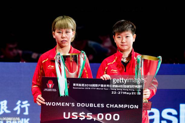 Chen Xingtong and Sun Yingsha of China pose with their prize after finishing against during women's doubles - final match against Chen Ke and Wang...