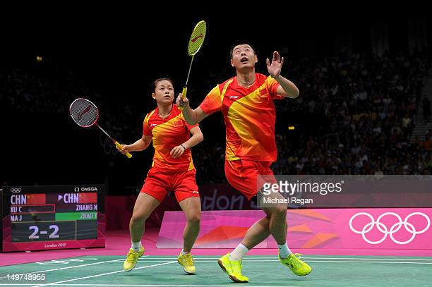 Chen Xu and Jin Ma of China compete in the Mixed Doubles Badminton Gold Medal match against compatriots Nan Zhang and Yunlei Zhao of China on Day 7...