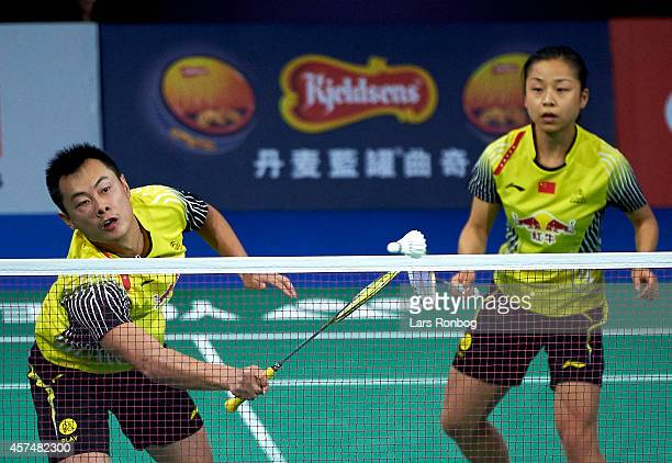 Chen Xu and Jin Ma of China in action in the Mixed Double final during the Yonex Denmark Open MetLife BWF World Superseries at Odense Idratspark on...