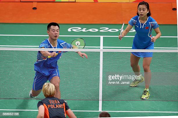 Chen Xu of China and Jin Ma of China competes against Nadiezda Zieba and Robert Mateusiak of Poland in the badminton Mixed Double on Day 7 of the...