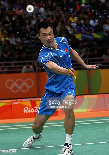Chen Xu of China of China competes against Nadiezda Zieba and Robert Mateusiak of Poland in the badminton Mixed Double on Day 7 of the 2016 Rio...
