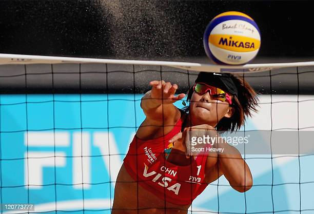 Chen Xue of China smashes the ball during their Preliminary Phase Pool B match against Greece during the VISA FIVB Beach Volleyball International at...