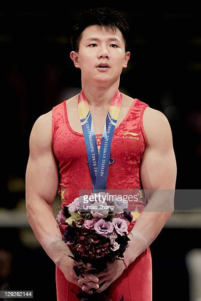 Chen Yibing of China stand on the podium celebrate after the Men's apparatus finals during the day nine of the Artistic Gymnastics World...