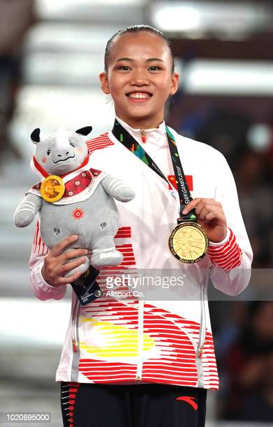 Chen Yile of China poses with her gold medal during the Artistic Gymnastic of the Women's Individual All-Around Final at the Jiexpo Hall on day three...