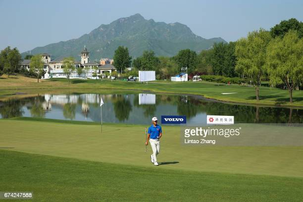 Chen Yilong of China looks on after plays a shot during the second round of the 2017 Volvo China open at Topwin Golf and Country Club on April 28...