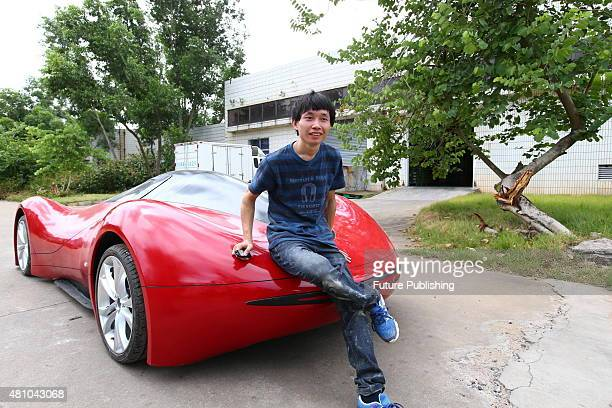 Chen Yinxi poses with his homemade electric car on July 17 2015 in Haikou in south China's Hainan province The 27yearold man completed his automotive...