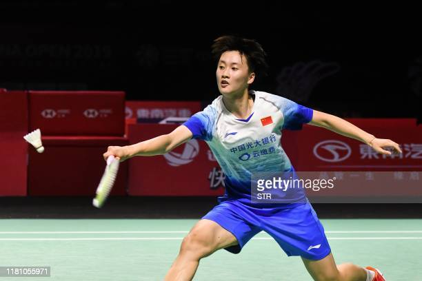 Chen Yufei of China hits a return against Michelle Li of Canada during their women's singles semifinal match at the Fuzhou China Open badminton...