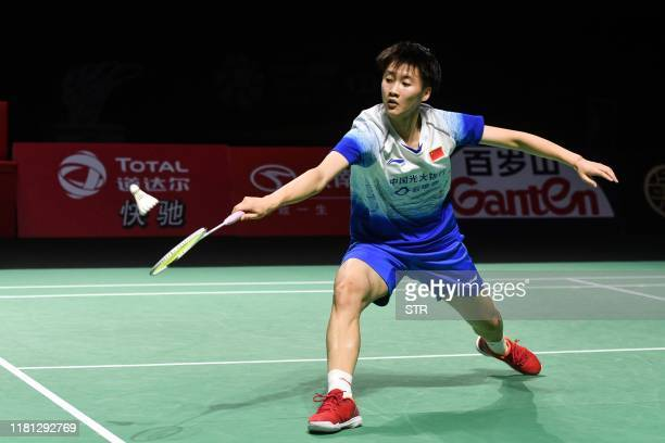 Chen Yufei of China hits a return against Nozomi Okuhara of Japan during their women's singles final match at the Fuzhou China Open badminton...