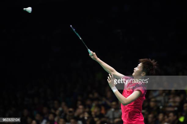 Chen Yufei of China hits a return against Sung JiHyun of South Korea during their women's singles semifinals match at the 2018 Badminton Asia...