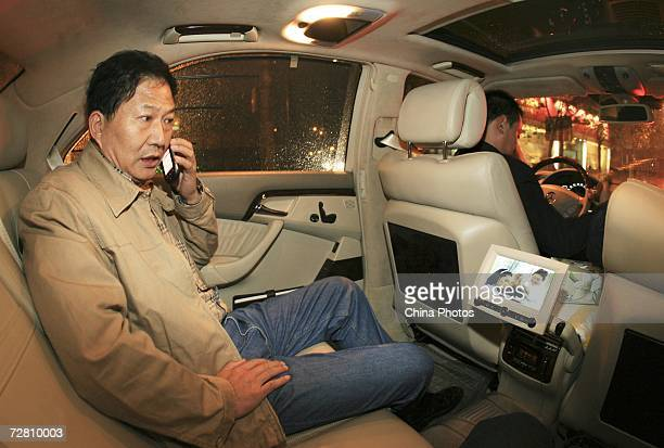 Chen Zhixian chairman and CEO of Sassin International Electric Appliance Shanghai Corp makes a phone call in his Benz sedan on December 11 2006 in...