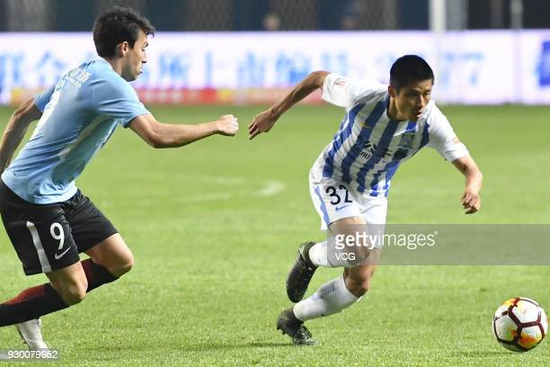Chen Zhizhao of Guangzhou RF drives the ball during the 2018 Chinese Football Association Super League second round match between Guangzhou RF and...