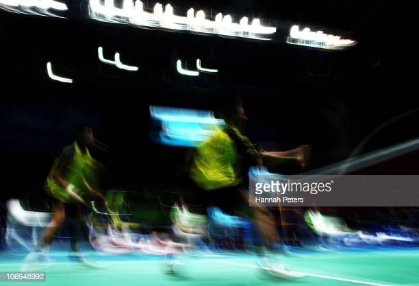 Chen Zu and Zhendong Guo of China in action in the Men's Doubles Badmington Quarterfinal Match against Mohammad Ashan and Alvent Yulianto Chandra of...