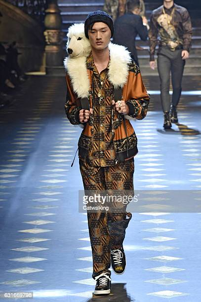 Cheng Cong walks the runway at the Dolce Gabbana Autumn Winter 2017 fashion show during Milan Menswear Fashion Week on January 14 2017 in Milan Italy
