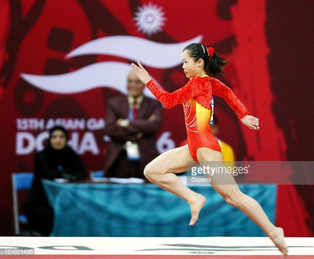 Cheng Fei of China wins the gold medal in the Women's Vault final during the Artistic Gymnastics competition at the 15th Asian Games in Doha, Qatar...