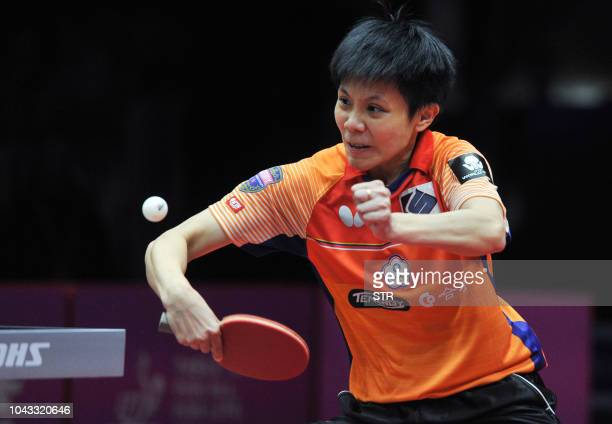 Cheng Iching of Taiwan plays a shot during her women's singles semifinal match against Zhu Yuling of China at the ITTF Women's World Cup table tennis...
