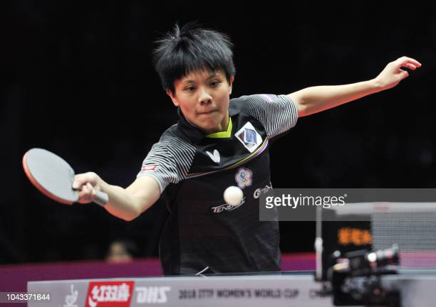 Cheng Iching of Taiwan plays a shot during her women's singles third place match against Kasumi Ishikawa of Japan at the ITTF Women's World Cup table...