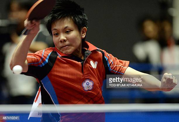 Cheng IChing of Taiwan returns the ball towards Kasumi Ishikawa of Japan during their women's singles 4th round match at the 2014 World Team Table...