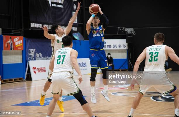 Cheng Ju Lu of Yulon Luxgen Dinos attempt to jump shot during the SBL Finals Game One between Taiwan Beer and Yulon Luxgen Dinos at Hao Yu Trainning...