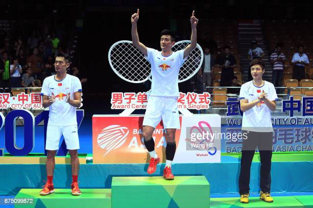 Cheng Long of China pose gold medals on the podium after winning the Men's singles against Lin dan of China at the 2017 Badminton Asia Championships...